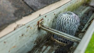 Unclog the Downspouts In Gutter Cleaning